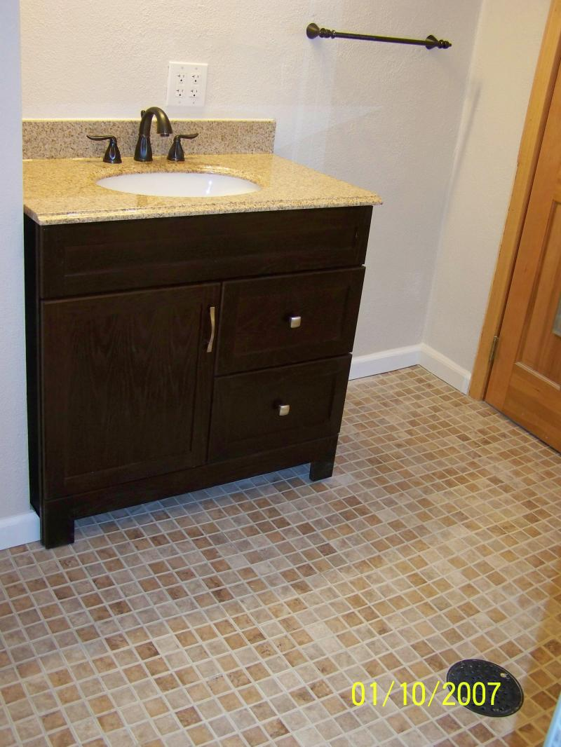 basement bathroom floor and new vanity installation
